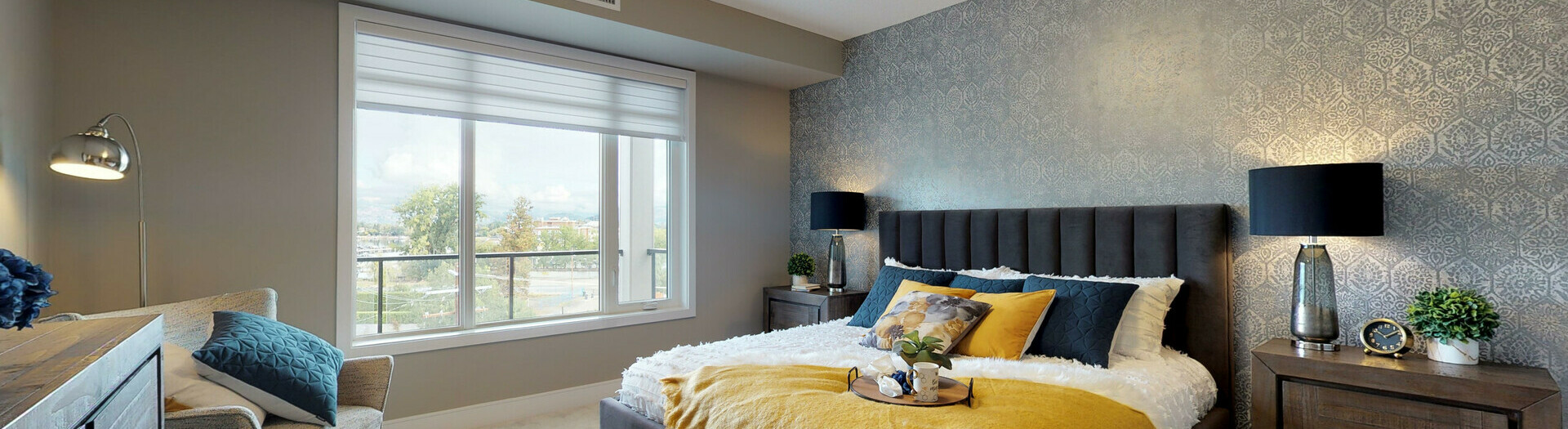 Master Bedroom in the Zephyr showsuite in the Essence Condo building in Mission Creek, Kelowna, British Columbia.